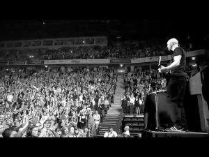 mark on stage with crowd bw